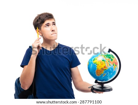 Pensive male student holding globe isolated on a white background. Looking up - stock photo