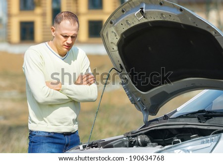 pensive man in a breaking cars on the road - stock photo