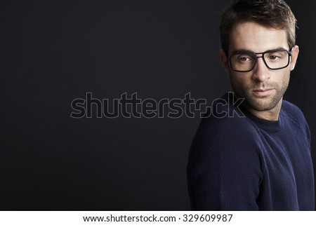 Pensive man looking away in spectacles