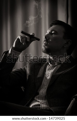 pensive man with cigar - stock photo