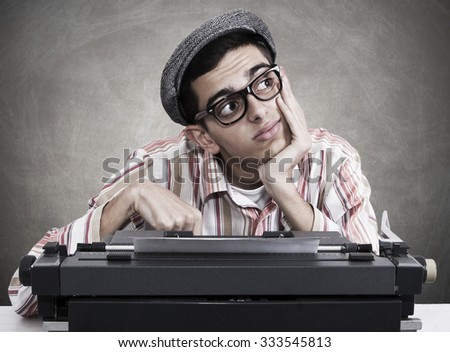 pensive man with typewriter