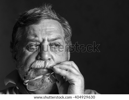 pensive mature man with glasses