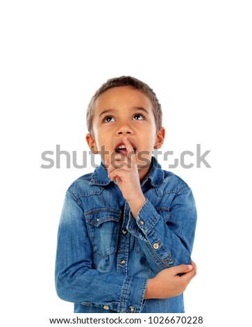 Pensive small child with denim t-shirt isolated on a white background