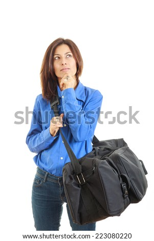 Pensive woman daydreaming going on vacation with large travel bag - stock photo