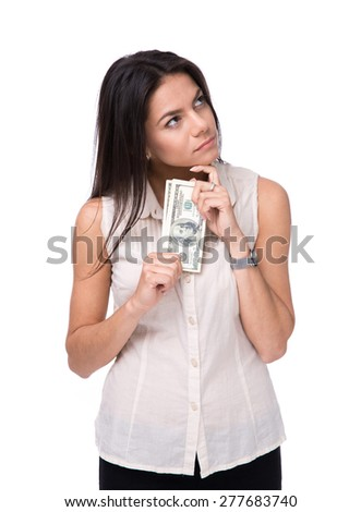 Pensive woman holding bills of dollar over white background and looking up - stock photo