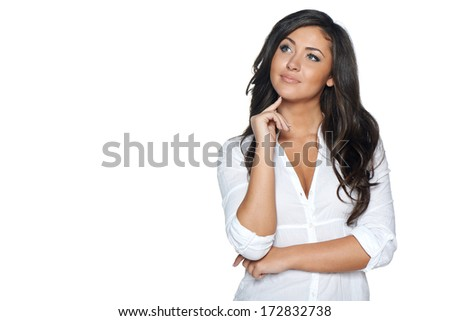 Pensive woman looking to the side at blank copy space, isolated on white background - stock photo