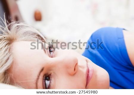 Pensive woman portrait still in bed. - stock photo