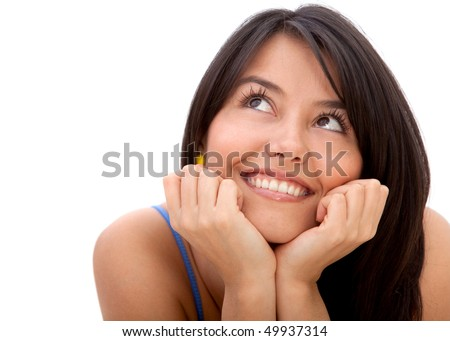 Pensive woman smiling isolated over a white background - stock photo
