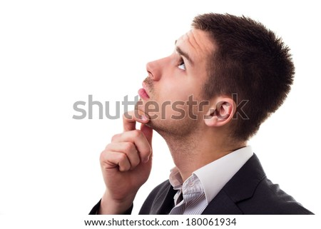 Pensive young businessman - stock photo