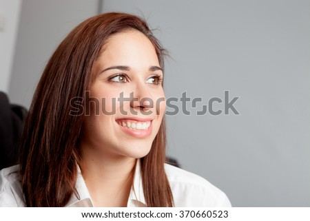 Pensive young girl relaxing at home looking at side