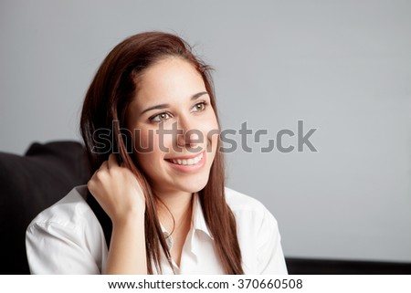 Pensive young girl relaxing on couch at home - stock photo