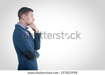 Pensive young handsome man in classical costume doubt think - stock photo