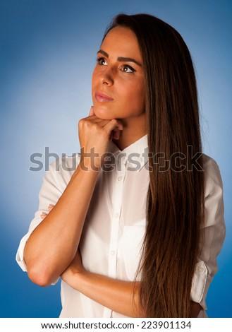 Pensive young hispanic woman thinking - stock photo