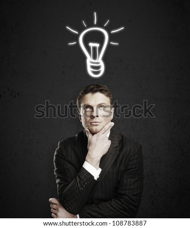 pensive young man with a drawing lamps over his head