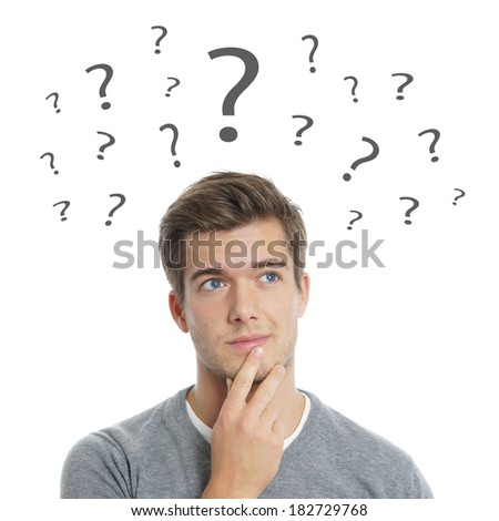pensive young man with question marks - stock photo