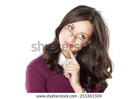 Pensive young woman with the glasses on a white background - stock photo