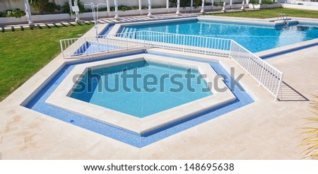 Pentagonal summer pool outside. For a vacation getaway. - stock photo