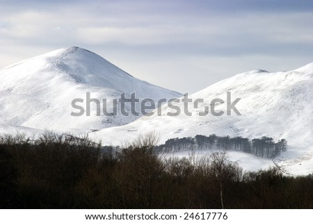 Pentland Hills in southern Scotland, covered in a late winter snow.
