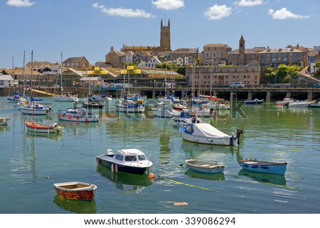Penzance, Cornwall, England - JULY 31: yachts and fishing boats in Penzance harbour and abbey Warehouse on July 31, 2015 in Penzance, Cornwall, England - stock photo