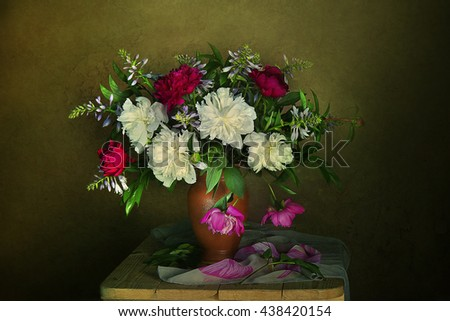 Peony flower in a vase in a still life .