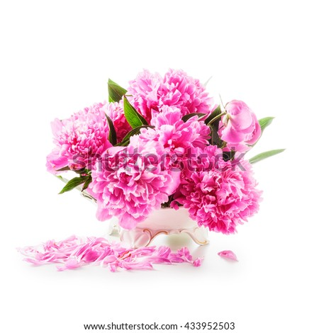 Peony flowers. Romantic bouquet of pink peonies in retro vase isolated on white background clipping path included. Holiday present