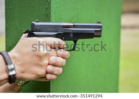 people aiming gun - stock photo