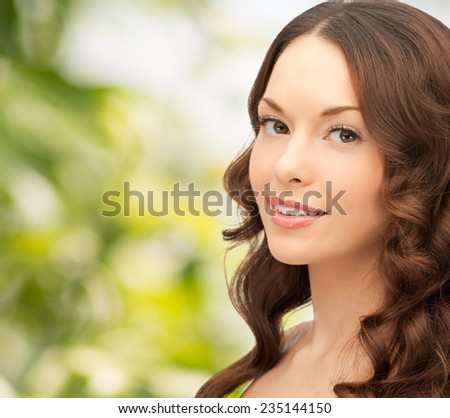 people and beauty concept - beautiful young woman over green background
