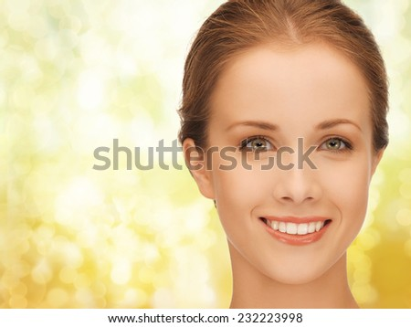 people and beauty concept - beautiful young woman over yellow lights background - stock photo