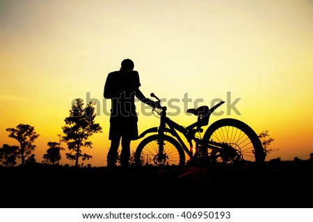 People and bicycle leisure at sunset