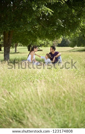 People and recreation, happy boy spending time with parents, playing in park with mother and father. Full length, copy space - stock photo