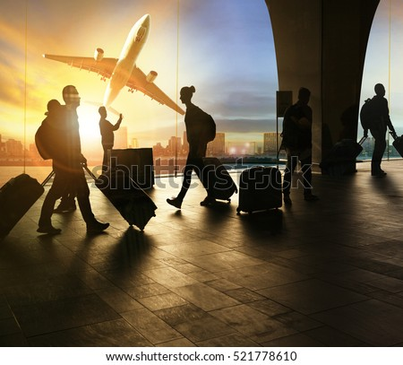 people and traveling luggage walking in airport terminal and passenger plane flying over urban scene