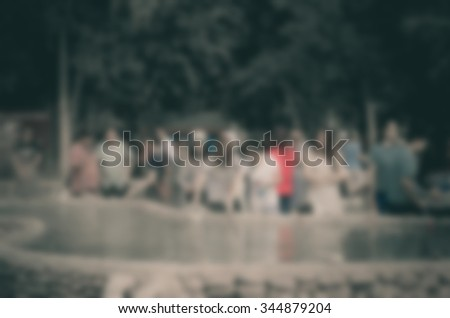 People are blurring together activities in the city. - stock photo