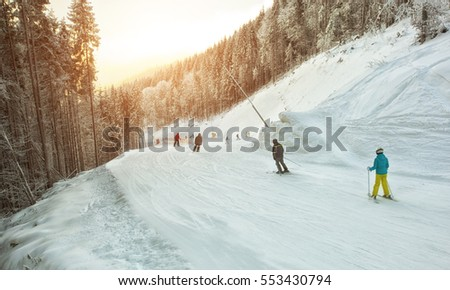 People are skiing in the mountains