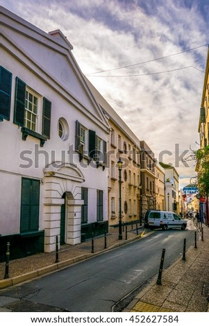 people are strolling through a narrow street of Gibraltar - stock photo