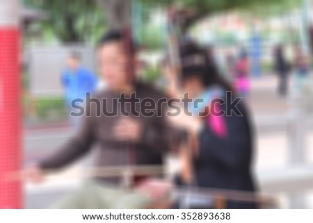 People are taught fiddling beetle Chinese pavilion blurred background. classic classical crafted craftsmanship cultural culture design entertainment equipment ethnic - stock photo