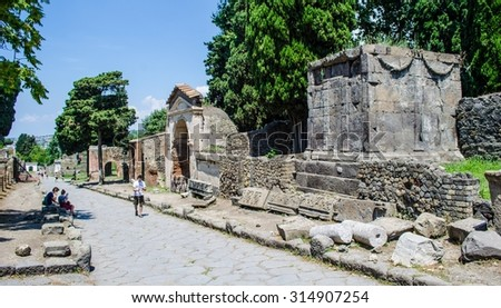 people are walking down the historical center of former city of pompeii near italian naples. - stock photo