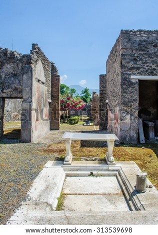 people are walking through the ruins of former italian city pompeii near naples. - stock photo