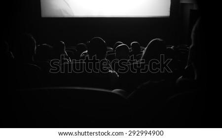 People are watching movie at the cinema. - stock photo