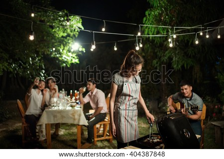 People asians barbecue party in the garden at night - stock photo