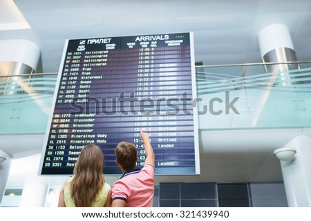 People at board at the airport - stock photo
