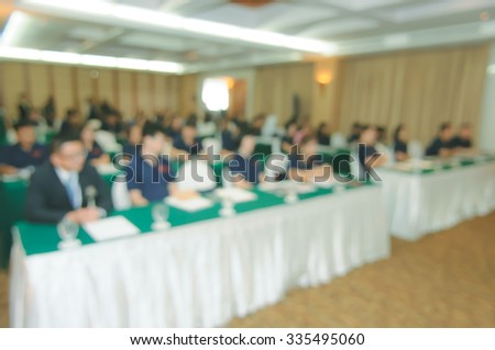 People at conference room blurred