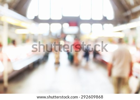 People at crowded place at market, unfocused effect - stock photo