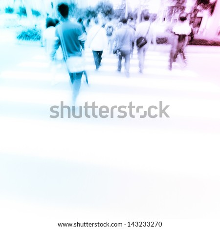 people at pedestrian crossing  in big city street blur motion