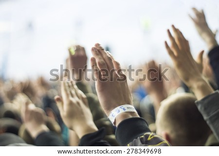 People at stadium - stock photo