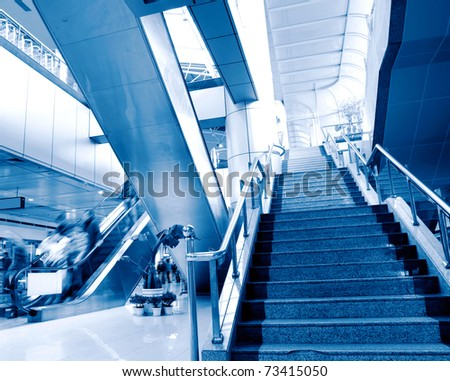 People at the airport escalator.Motion blur