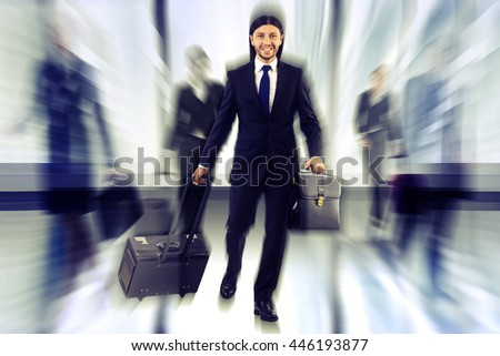 People at the airport with luggage