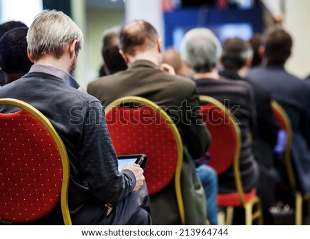 People at the conference hall. Rear view - stock photo
