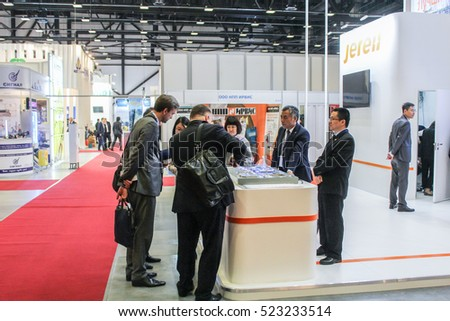 People at the counter of the company. St. Petersburg, Russia - 5 October, 2016. Petersburg Gas Forum which takes place in Expoforum.
