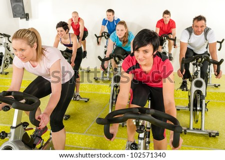 people at the gym enjoy physical workout - stock photo