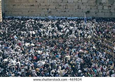 People at the wailing wall. - stock photo